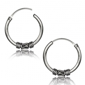 \\\'\\\'Mahaan khodana\\\'\\\' chiseled silver earrings